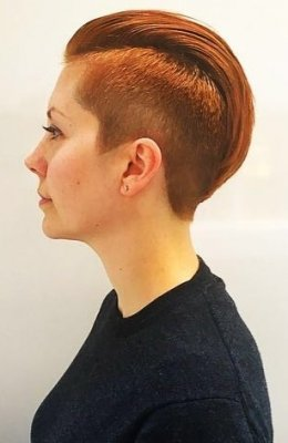Womans haircut slickback with shaved sides by Mark at the klinik salon London