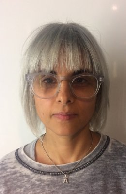 hair colour being faded from blond to dark grey to light grey at the klinik salon Farringdon