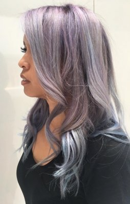 Hair being pre lightened and then coloured with pastel tones from grey, blue, purple and pink. done by Thea at the klinik hairdressing London.
