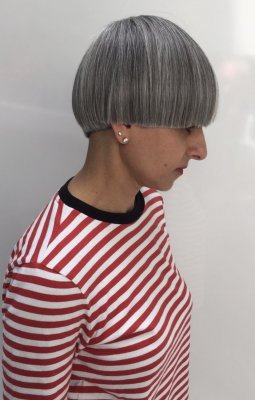 A natural grey haired bob has been cut into a bowl cut by Mark at the klinik hairdressing in London