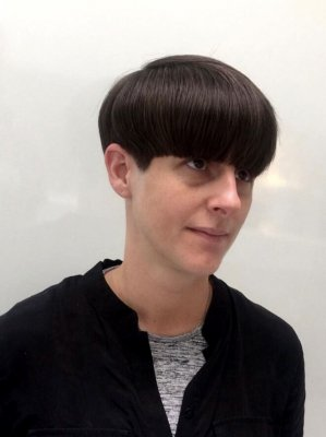 Thick dark hair has been cut into a bowl cut by Mark at the klinik hairdressing. He finished off by blowdrying it smooth with a denman brush and using Redken argain Oil to seal the finish!