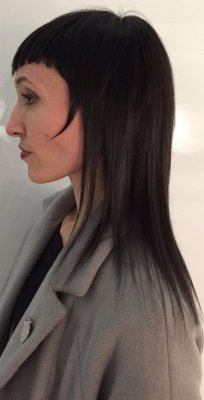 Long hair being cut by Mark at the klinik hairdressing in London giving it a modern take on the mullet using scissors and razor.