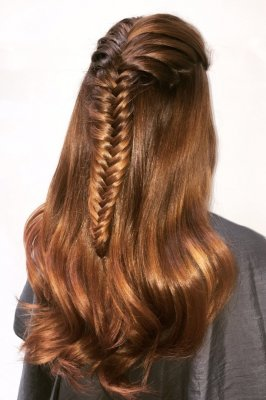 Hair being plaited into a fishtail finished detail through the top only done by Letla at the klinik hairdressers London