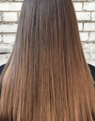 Hair has been coloured into a soft subtle balayage using tones of beige blond to not get any harsh lines.