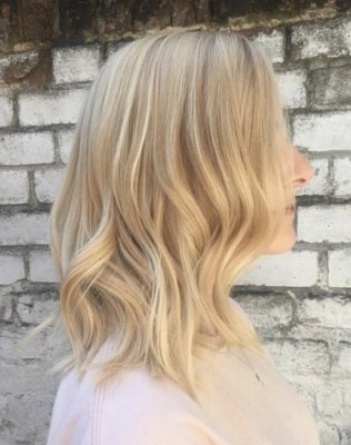 Blonde hair being highlighted with wella pre lightener and the toned into a creamy blonde by Leyla at the klinik. Finish off with GHD irons to give a tousled finish.
