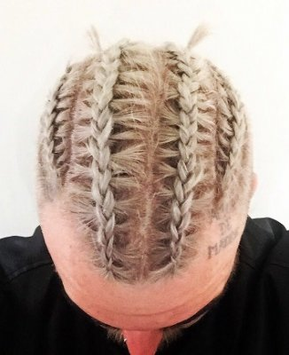 Graduate stylist Nik has created cornrow on a short hair at the klinik hairdressing London