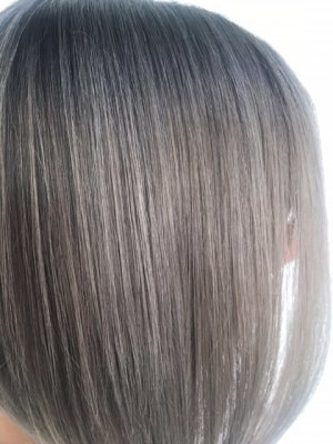 Hair being coloured into a Slate grey using Schwarzkopf and Kenra by Leyla at the klinik salon