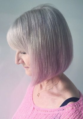 Natural white hair has been dip dyed with a soft pink on the tips of the hair by Leyla at the klinik