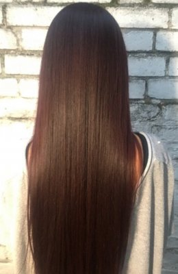 Natural long hair has been enhanced by applying a beautiful rich diarichesse brown plum by L'Oreal.