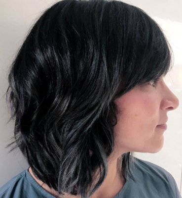 Shoulder long hair being coloured using kenra metallics to create a blue black metallic finish by Thea at the klinik hairdressing London