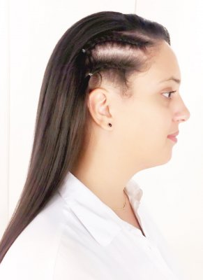 Long dark hair being blowdried straight with an extra two cornrows on the side to give it an extra twist by Yasmin and Sam at the klinik hairdressing London EC1R 4QE