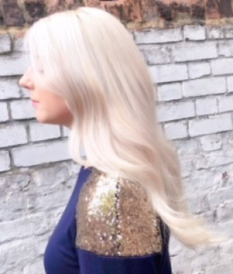 Long hair has been highlighted to create a platinum blonde with Olaplex by Letla at the klinik hairdressing in London