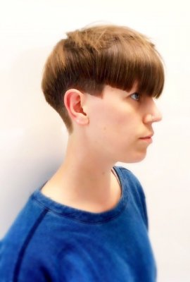 Ladies androgynous cut with a bowl shaped fringe cut by Mark at the klinik hairdressing Islington