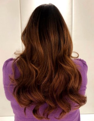 Brown/red hair being extended usin Easilocks sytem by Leyla at the klinik hairdressing London