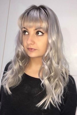 silvery blond hair is kept still in a good tone and shine by using the correct after care products to maintain its tone at the klinik hairdressing London.