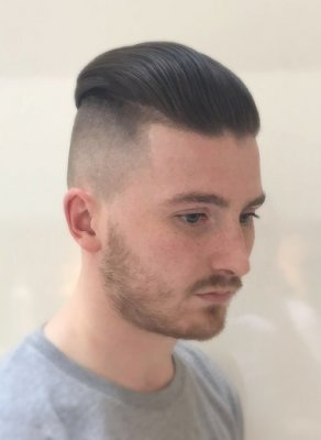 A shaved slickback barbering look done by Mark at the klinik salon