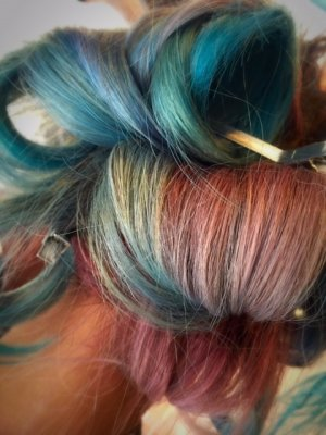 Hair being coloured in multi colour from pink, blue, silver by Thea at the klinik hairdressing London