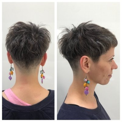 A short hair has been shaved underneath to create a flatter side and give a disconnected top layer throughout the haircut.