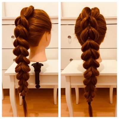 Dolls head with a pull through braid done by Leyla at the klinik hairdressing