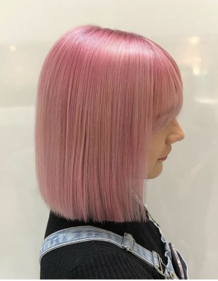 Blonde hair being coloured pink using Goldwell Pastel Rose by Leyla at the klinik hairdressing London
