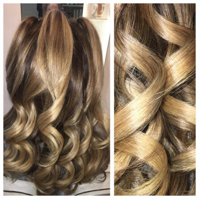 Long blond hair being tonged by a ghd irons to create a tight curl for the fesive season by Yasmin at the klinik Salon LOndon