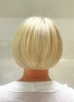 A short bob has been cut to expose the neckline in the hottest of weathers. Hair done by Anna at the klinik hairdressing ondon