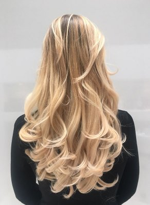 Long hair being coloured blonde and blowdried with a bouncy blowdry by Leyla at the klinik salon London.