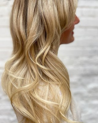 Girl with long blonde hair having had it refreshed by Leyla at the klinik salon