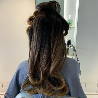 Long hair being pin curled and blow dried at the klinik salon London