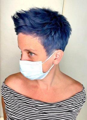 A girl with short blue hair