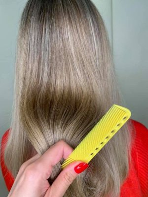 Highlighted hair with a yellow comb at the klinik salon London