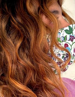 Close up of copper curls done by Leyla at the klinik hairdressing London