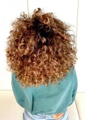 Big curly hair coloured natural sunkissed at the klinik salon London