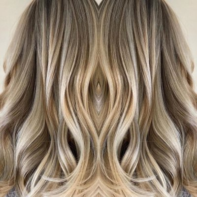 Blonde highlights with dark pieces in between at the klinik hairdressing London