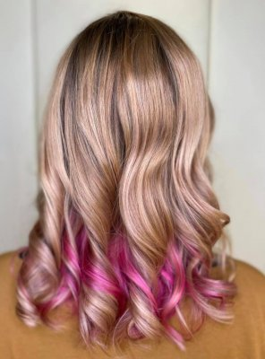 Pink balayage from blonde roots
