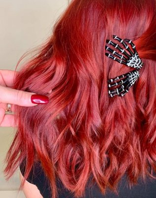 bright red hair with two halloween hand as hair clips at the klinik salon London