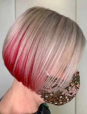 Blonde hair with a red panel at the neckline at the klinik salon London