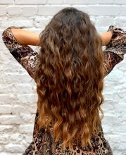 Girl with leopard spot dress and long mermaid hair at the klinik salon London