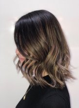 medium length hair with a soft balayage going from dark  to light with a soft wave done by Leyla at the klinik