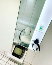 white and black salon with a white hairdressing chair with a retro monitor at the klinik salon