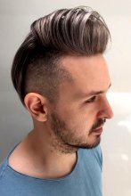 Gents cut colured in the quiff with baby lights and then toned grey. Hair cut is a high fade with leaving it long on top. all done by Mark at the klinik hairdressing in London