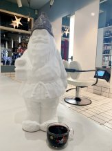 White Santa standing drinking mulled wine at the klinik salon