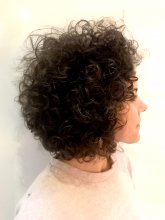 Natural curly hair cut by Anna at the klinik hairdressing London.