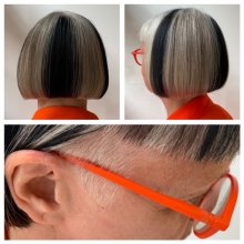 Orange glasses on a lady with black and grey hair done by Anna at the klinik salon London