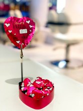 Love hearts and chocolates from Lindt standing on the white sofa at the klinik salon celebrating Valentines Day.