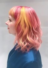 shoulderlength hair coloured pink and yellow by Anna at the klinik hairdressing London
