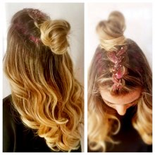 Plaited hair with a top bun and diamantes and red hair glitter for a hair festival look at the klinik hairdressing London