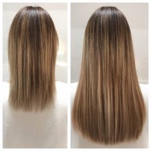 Off the shoulder length hair being lengthened using Easilocks system done by Leyla at the klinik hairdressing London.