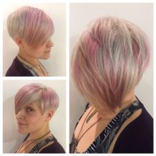 A short ladies haircut with a long fringe pre coloured whie and then toned into a soft Pink by Leyla at the klinik hairdressing in London.