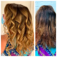 Before and after picture of a dark box dye hair coloured inro a caramel balayage by Anna at the klinik salon London